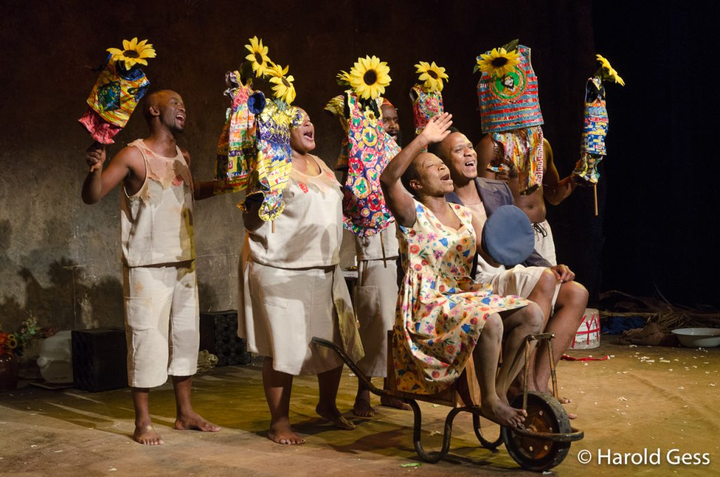 Chuma Sopotela and Bongile Mantsai perform witht he rest of the cast in a scene from Karoo Moose, written and directed by Lara Foot, at the National Arts Festival, Grahamstown, South Africa, 2016.